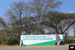 A man walks past a banner ahead of Sunday's inauguration of Zimbabwean President Emmerson Mnangagwa in Harare, Zimbabwe, Aug, 25, 2018.
