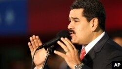 FILE - Venezuela's President Nicolas Maduro, delivers a speech at the Fort Tiuna military base in Caracas, Oct. 27, 2014.