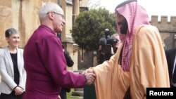 Britain's Archbishop of Canterbury Justin Welby greets the Crown Prince of Saudi Arabia Mohammed bin Salman as he arrives at Lambeth Palace, London, March 8, 2018.