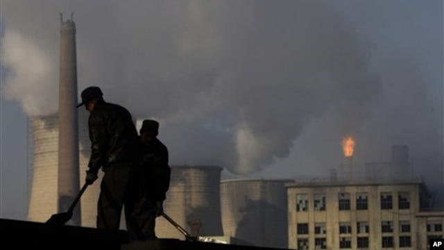 Cooling towers of a power plant and chemical factory in China. Among the 1,200 proposed coal-fired power plants 76 percent will be built in China and India, already among the top emitters of climate changing greenhouse gases.