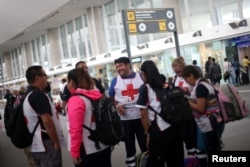 Members of Mexico's Red Cross are pictured before travelling to Houston to provide humanitarian aid at Benito Juarez International airport in Mexico City, Aug. 30, 2017.