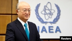 FILE - International Atomic Energy Agency (IAEA) Director General Yukiya Amano arrives for a board of governors meeting at the IAEA headquarters in Vienna, Nov. 20, 2014.