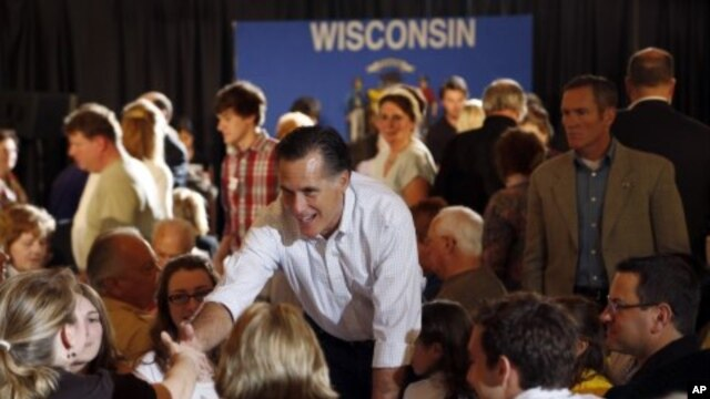 U.S. Republican presidential candidate Mitt Romney greets supporters after speaking at a pancake breakfast in Wauwatosa, Wisconsin, April 1, 2012.