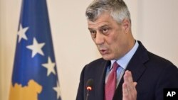 FILE - Kosovo president Hashim Thaci reacts during a press conference in capital Pristina, Kosovo, March 8, 2017.