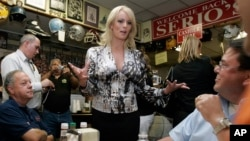 FILE - Stormy Daniels visits a local restaurant in New Orleans, May 6, 2009. Daniels was exploring the possibility of challenging incumbent Louisiana U.S. Sen. David Vitter.