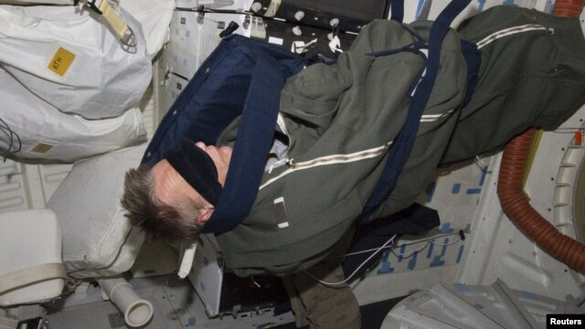 Astronaut Piers Sellers, STS-132 rests in his sleeping bag on the middeck of the space shuttle Atlantis in this photo provided by NASA and taken May 17, 2010.