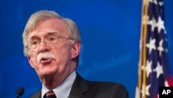 FILE - National Security Advisor John Bolton unveils the Trump Administration's Africa Strategy at the Heritage Foundation in Washington, Dec. 13, 2018.