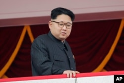 FILE - North Korea's leader Kim Jong Un watches a parade in Pyongyang.