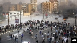Egyptian protesters during clashes with anti-riot policemen in Suez, Egypt, Jan. 27, 2011