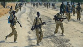 Sudan People's Liberation Army (SPLA) soldiers patrol a road in Mathiang near Bor, Jan. 31, 2014.
