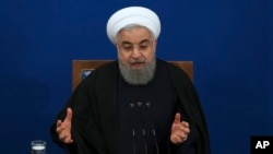 Iranian President Hassan Rouhani speaks during a news conference at the presidential compound in Tehran, Feb. 6, 2018.