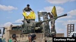 ក្រុមទាហានដែលចូលរួមក្នុងប្រតិបត្តិការរំដោះក្រុង Raqqa នៅប្រទេសស៊ីរី ពីពួករដ្ឋឥស្លាម កាលពីថ្ងៃទី២៤ ខែឧសភា ឆ្នាំ២០១៦។