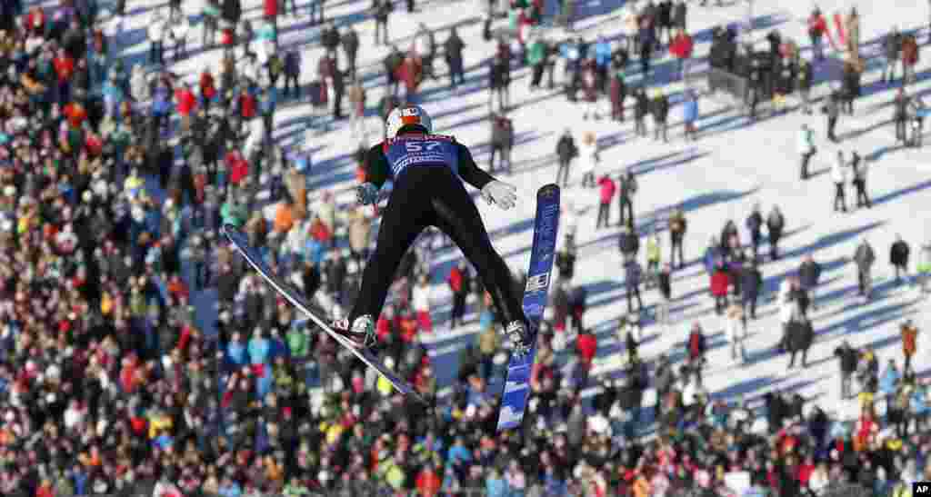 Austria's Thomas Diethart soars during his trial jump at the second stage of the four hills ski jumping tournament in Garmisch-Partenkirchen, southern Germany.