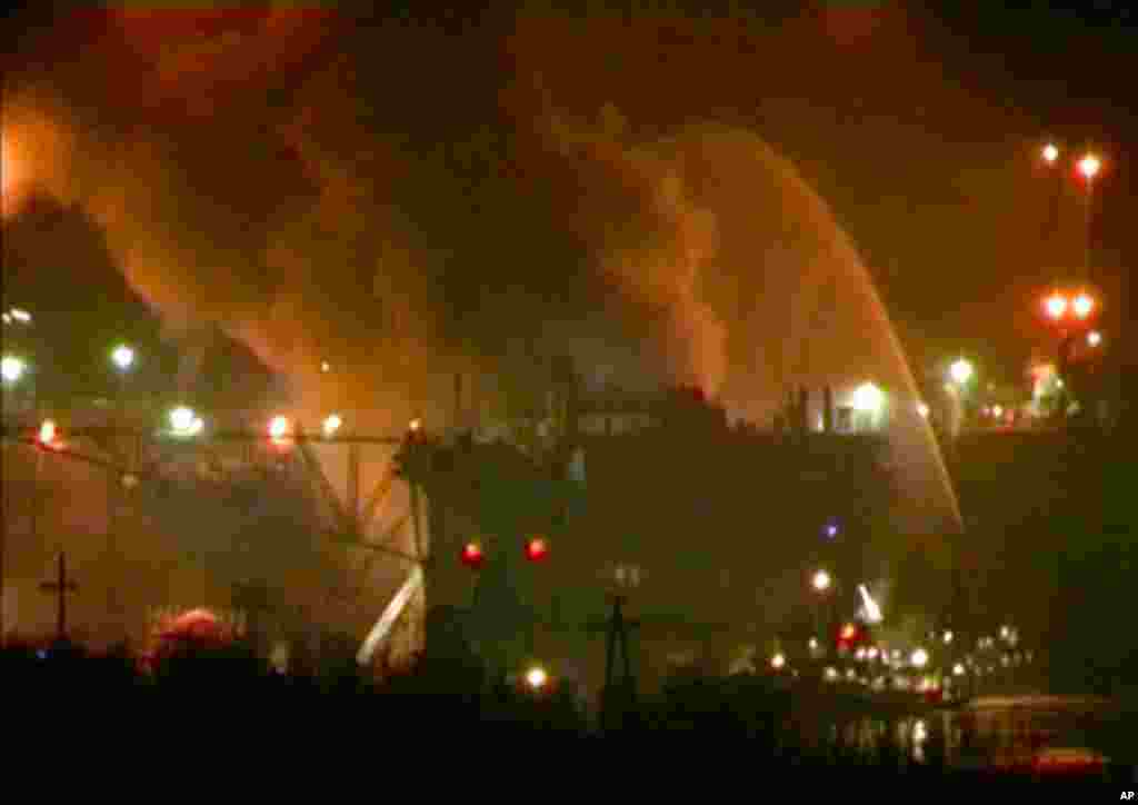 In this framegrab image from Ru-RTR Russian state channel, smoke rises from a dock where the Yekaterinburg nuclear submarine is for repairs at the Roslyakovo shipyard. (AP Photo)