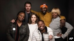 "Director Dee Rees, from left, actors Garrett Hedlund, Rob Morgan, Mary J. Blige, Carrey Mulligan, center, and Jason Mitchell, bottom, pose for a portrait to promote the film, ""Mudbound,"" at the Music Lodge during the Sundance Film Festival, Jan. 21, 2017, in Park City, Utah."