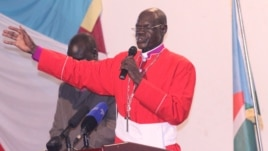 A Catholic priest leads the congregation in prayer in Juba in July 2012.