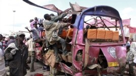 Residents look for survivors in wreckage of passenger mini-bus that was bombed in the Eastleigh suburb of Nairobi, Kenya, Nov. 18, 2012.