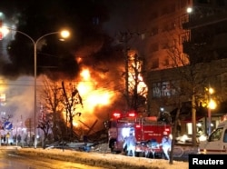 A view of a site of an explosion at a bar in Sapporo, Japan, Dec. 16, 2018 in this still image taken from a video obtained from social media.