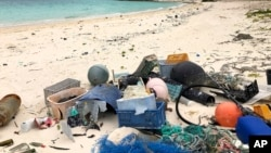 In this Oct. 22, 2019, photo, plastic and other marine debris sits on the beach on Midway Atoll in the Northwestern Hawaiian Islands. (AP Photo/Caleb Jones)