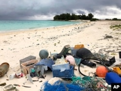 In this Oct. 22, 2019, photo, plastic and other marine debris sits on the beach on Midway Atoll in the Northwestern Hawaiian Islands.