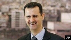 Le président syrien Bashar Assad, à droite, lors d'une réunion à Damas, en Syrie, en mars 2008.