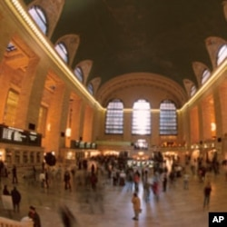 Passengers wait for trains in the United States, where immigrants can help bolster the working age population.