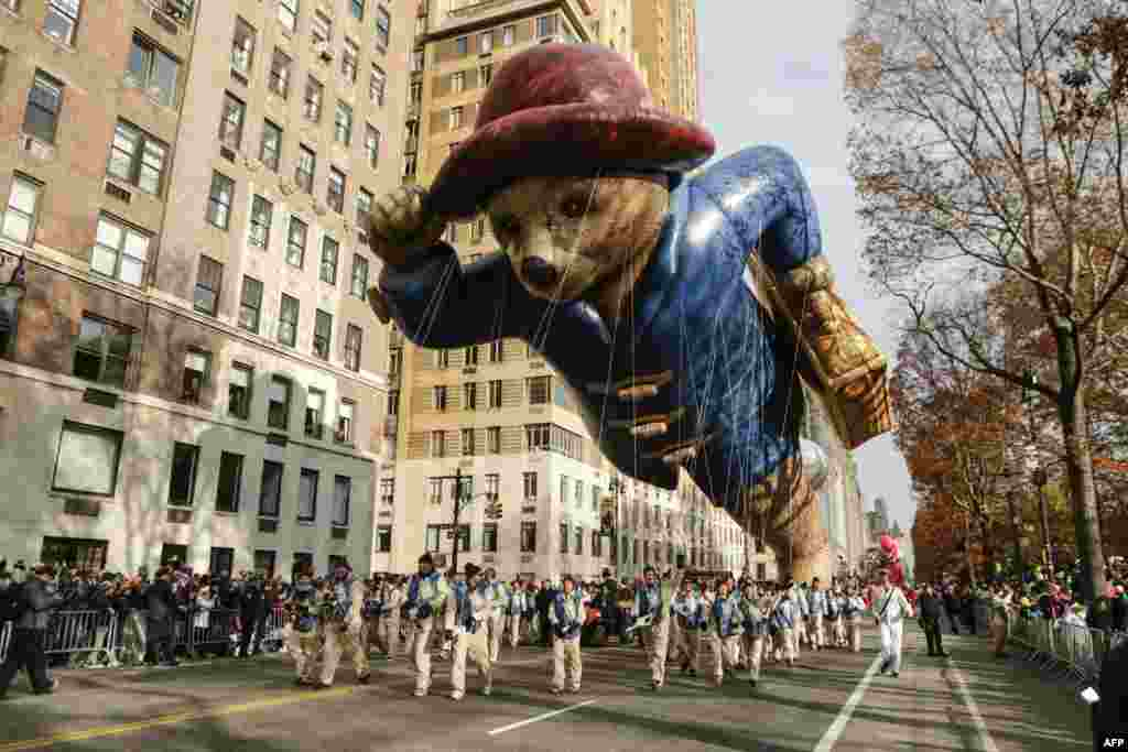 The Paddington Bear balloon floats down Central Park West during the 90th annual Macy's Thanksgiving Day Parade in New York.