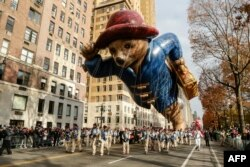 The Paddington Bear balloon floats down Central Park West during the 90th annual Macy's Thanksgiving Day Parade.