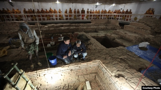 Archaeologists Robin Coningham (left) and Kosh Prasad Acharya direct excavations within the Maya Devi Temple, uncovering a series of ancient temples contemporary with the Buddha. Thai monks meditate. (Photo by Ira Block/National Geographic)