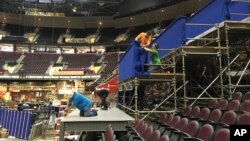 FILE - Workers prepare a camera platform inside Quicken Loans Arena in preparation for the Republican National Convention in Cleveland, June 28, 2016.