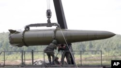 FILE - Russian servicemen equip an Iskander tactical missile system in Kubinka, outside Moscow, Russia, June 17, 2015. Russia has reportedly deployed the ground-launched SSC-8 cruise missile it has been developing and testing for several years.