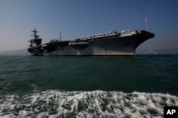 FILE - The aircraft carrier USS Carl Vinson is anchored in Hong Kong waters.