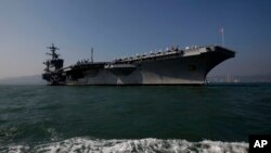 FILE - The aircraft carrier USS Carl Vinson is shown off Hong Kong, Dec. 27, 2011.
