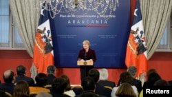 """Chile's President Michelle Bachelet delivers a message asking for forgiveness from indigenous Mapuche people for """"errors and horrors"""" committed by the state and announcing plans to give them more power and resources, at the government house in Santiago, Junr 23, 2017."""