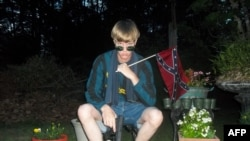 This undated photo taken from Lastrhodesian.com allegedly shows Dylann Roof. The website, which surfaced after the murder of nine parishoners at an African American Church in Charleston, South Carolina, also included a white supremacist manifesto.