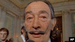 FILE - Spanish surrealist painter Salvador Dali is pictured at an exhibition in Paris, May 21, 1973.