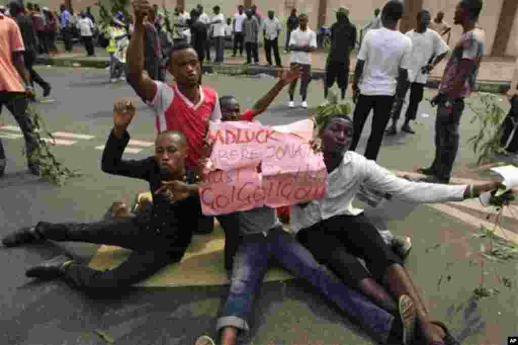 People protest on the second day of the ongoing strike following the removal of fuel subsidy by the government in Lagos, Nigeria, Tuesday, Jan. 10, 2012. As Nigeria's nationwide strike starts its second day, angry youths have erected a burning roadblock