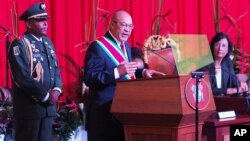 Suriname's President Desi Bouterse, re-elected to a second, five-year term, delivers his inaugural speech in Paramaribo, Aug. 12, 2015.