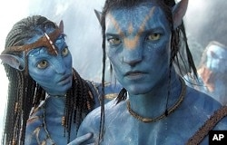 Zoe Saldana and Sam Worthington in scene from Avatar