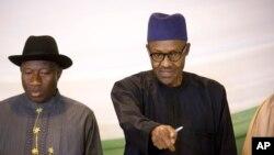 Rais anayeondoka madrakani Goodluck Jonathan, na rais aliyeshinda uchaguzi nchini Nigeria Muhammadu Buhari