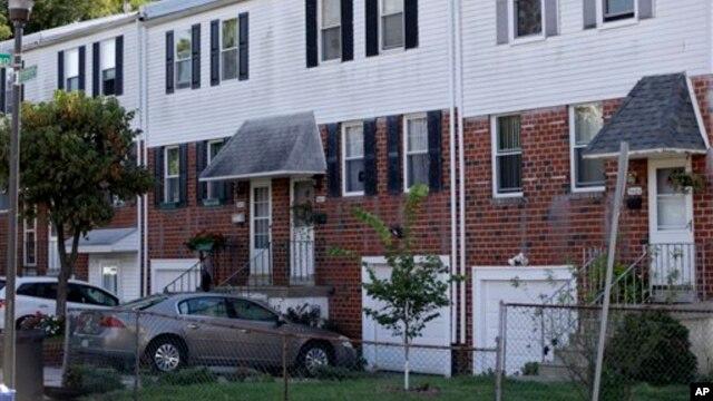 """FILE- Home of suspected former Nazi SS guard Johann """"Hans"""" Breyer, center, in Philadelphia, Pennsylvania, Sept. 19, 2012."""