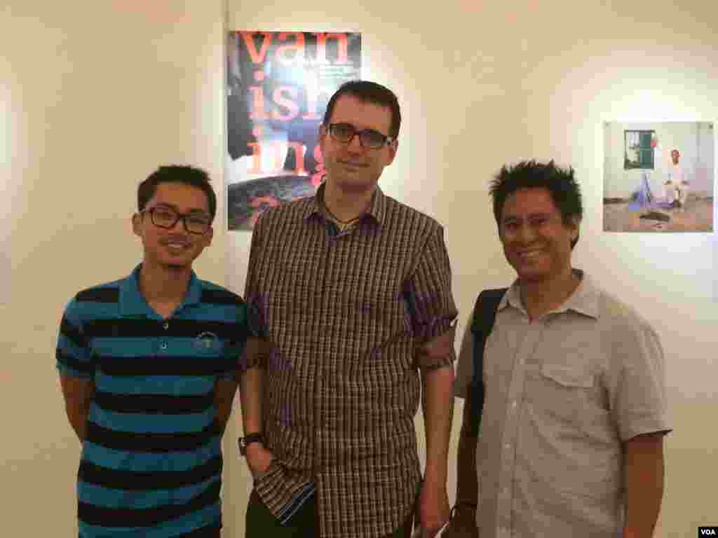 Author Ryun Patterson and photographer Rick Valenzuela posed with a Cambodian student who helped with the translation of the 'Vanishing Act'.