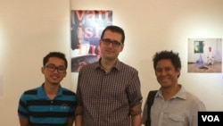 Author Ryun Patterson and photographer Rick Valenezuela posed with a Cambodian student who helped with the translation of the 'Vanishing Act'.