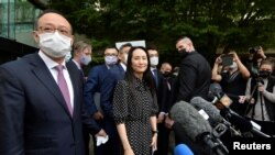 華為公司首席財務官孟晚舟9月24號在加拿大溫哥華一家法院作出裁決後離開法院。