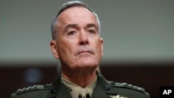 FILE - Joint Chiefs Chairman Gen. Joseph Dunford listens on Capitol Hill in Washington while testifying.