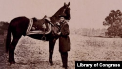 "Ulysses S. Grant standing with his war horse, ""Cincinnati"""