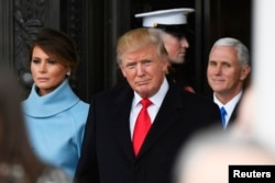 FILE - President Donald Trump and Melania Trump depart the 2017 Presidential Inauguration at the U.S. Capitol, Jan. 20, 2017. Vice President Mike Pence is at right.