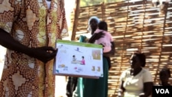 FILE - A health worker explains birth control at a clinic outside Juba, South Sudan. (H. McNeish/VOA)