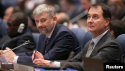 Members of the Russian delegation listen to proceedings at the International Civil Aviation Organization's (ICAO) global safety meeting in Montreal, Feb. 3, 2015.