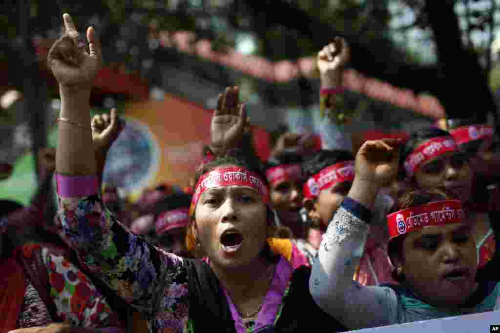 Bangladeshi garment workers shout slogans as they participate in a May Day rally in Dhaka, Bangladesh, May 1, 2017.